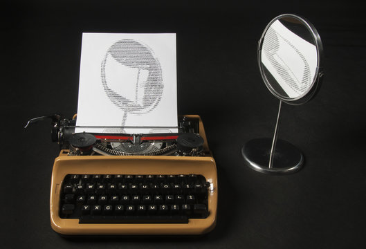 The picture of mirror self-reflection created with letters on an old typewriter