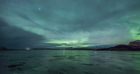 Wall Mural - Northern lights on a frozen beach