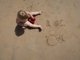 baby drawing on sand