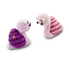 knitted Garden snail in front of a white background
