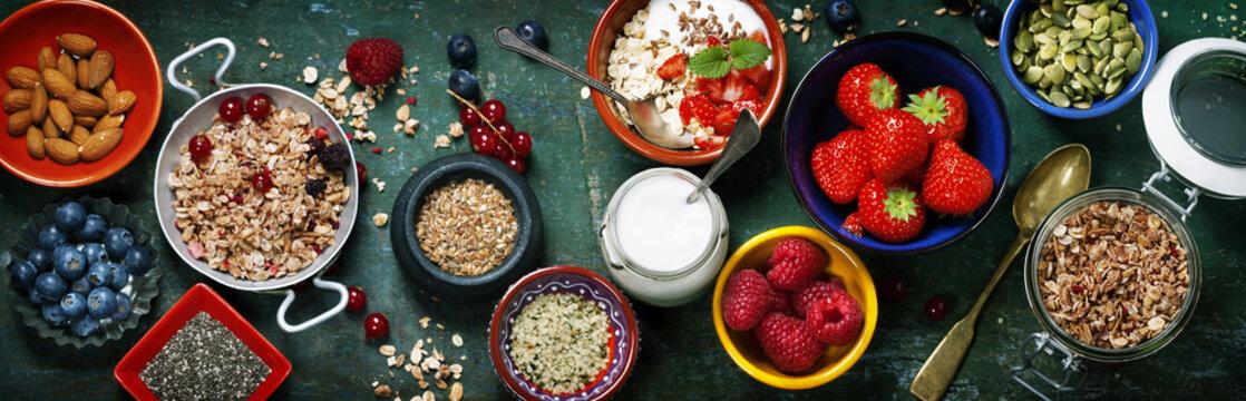 Healthy breakfast of muesli, berries with yogurt and seeds