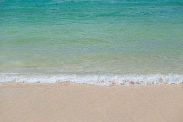 Wall Mural - Selective focus on Gentle waves with tropical beach