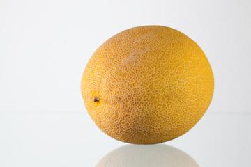 Galia melon on the glass desk