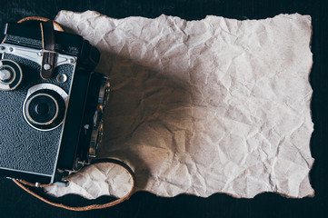Beige crumpled paper with vintage camera for valentine backgroun