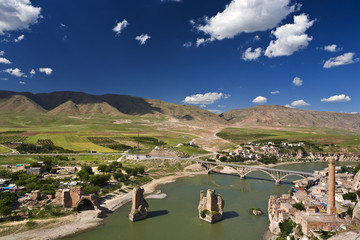 Turkey. Hasankeyf village (Southeastern Anatolia). Aerial view from the Fortress on the Tigris River with remains of the Old Bridge (broken arches and pylons)