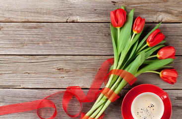 Red tulips and coffee cup