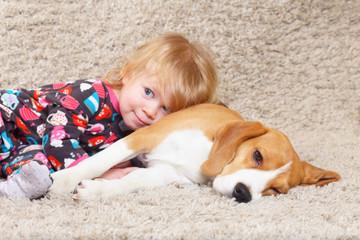Beagle dog and a little girl
