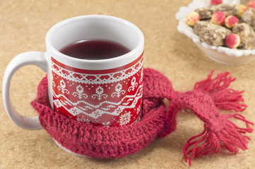 Cozy cup of tea with candies