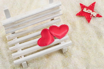 Two hearts on a miniature wooden bench