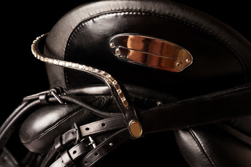 Black leather premium dressage saddle  isolated. close up