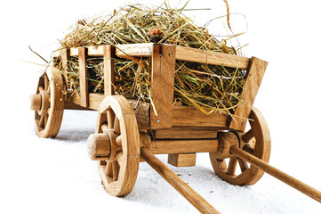Wooden hay cart on a white background