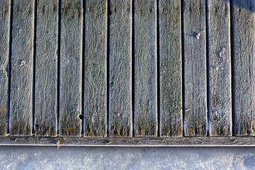 Frozen planks of old pier at winter morning