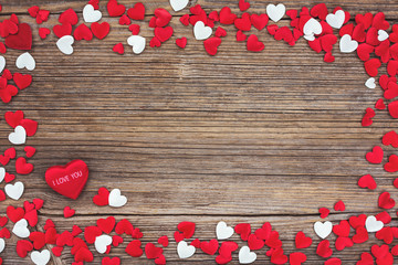 Valentines Day background with red and white hearts. Toned, soft focus
