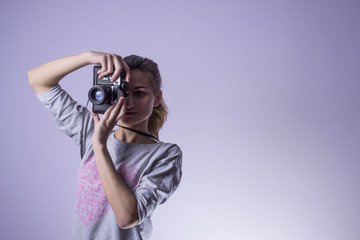 girl photographer takes a picture