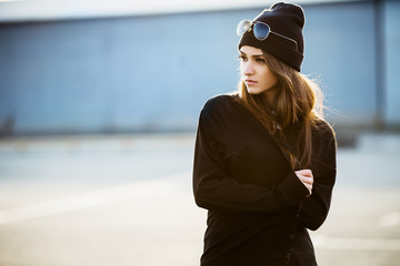 Outdoor fashion closeup portrait of nice pretty young hipster wo