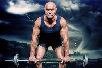 Composite image of portrait of muscular man exercising