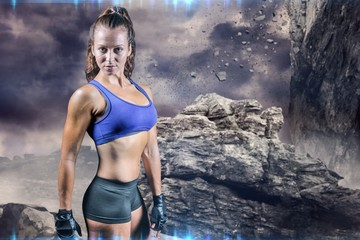 Composite image of portrait of sporty woman with gloves