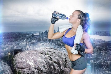Composite image of fit woman drinking water