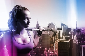 Composite image of thoughtful athlete lifting crossfit