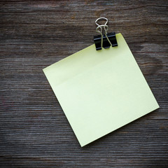 blank paper note on wood board background
