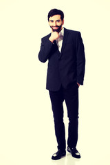 Young handsome businessman standing.