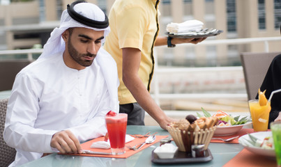 Handsome Arab Emirati Man Is Dining Outdoor