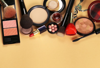 cosmetics set for make-up (face powder, lipstick, mascara brush, nail polish, blush, eye shadow)