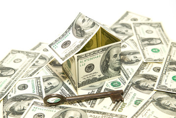 US dollar banknotes on display in the shape of a house on over w