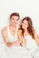 Happy smiling couple in love at home embracing each other with c