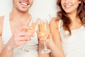Close up photo of couple in love with glasses of champagne