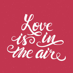 Love is in the air – romantic hand drawn lettering poster. Vector calligraphic quote.