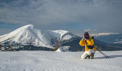 taking landscape shot in winter mountains