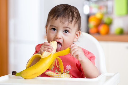 Cute baby eating banana