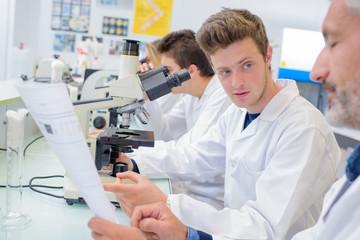 men in the laboratory