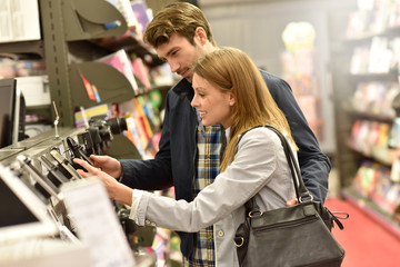 Couple in department store choosing smartphone
