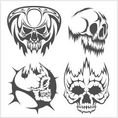Skulls with tribal elements vector set.