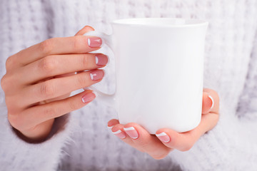 Fototapete - Girl with beautiful manicure hold cup in hand.