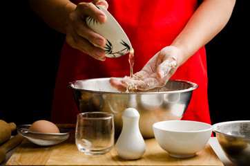 Preparation bread cooking,pouring egg in the bowl