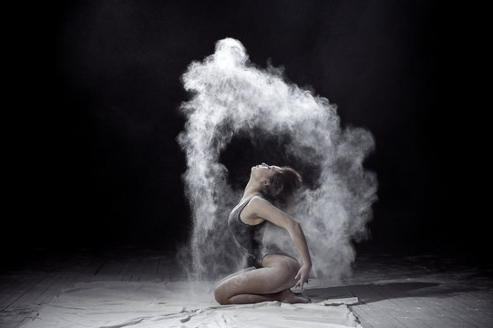 Girl dancing with a flour