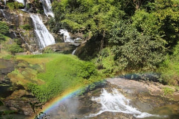 Small waterfall in Thailand with rainbow.
