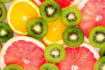 Bright background with kiwi fruit, grapefruit and oranges