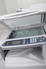 Front view of the office photocopier with numeric pad