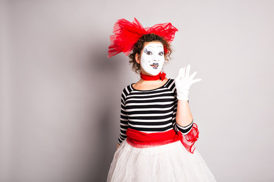 Portrait of a comedian  woman dressed up as a mime, April Fools Day concept