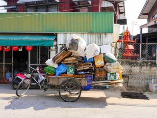 NAKHONRATCHASIMA ,THAILAND - FEBRUARY 3 :   tricycle  junk dealer  ask to buy some junks and papers for recycle factory at Nakhonratchasima ,THAILAND