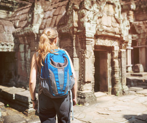 Tourist walking into the Preah Khan temple in Angkor, Cambodia