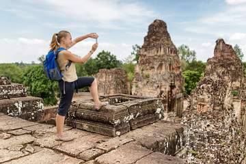 Tourist taking picture of the Pre Rup temple, Angkor, Cambodia
