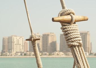 Boat rope with Doha skyline, Qatar