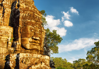 Wall Mural - Giant stone face of Bayon temple. Angkor Thom, Cambodia