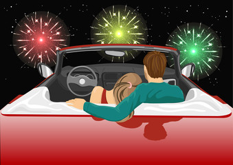 couple sitting in red convertible car enjoying a fireworks show