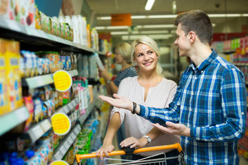 family purchasing infant food
